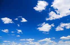White clouds over blue sky stock photography