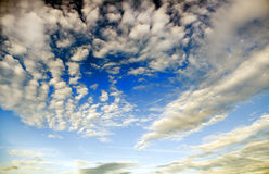White clouds over blue sky stock images