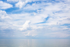 White clouds over calm blue water Sea of Azov Royalty Free Stock Photos
