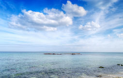 White clouds over Castelsardo coastline Stock Photography
