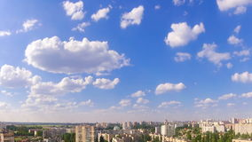 White Clouds over the City. Time Lapse stock footage