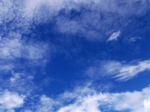 White clouds over a clear blue sky in Mexico City. Picture of some white clouds over a blue sky on a sunny day in Mexico City Royalty Free Stock Photos