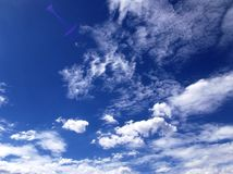 White clouds over a clear blue sky in Mexico City. Picture of some white clouds over a blue sky on a sunny day in Mexico City Stock Photos