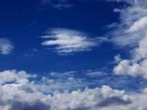 White clouds over a clear blue sky in Mexico City Royalty Free Stock Photos