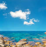 White clouds over Costa Paradiso. White clouds over the turquoise sea in Costa Paradiso Royalty Free Stock Photo