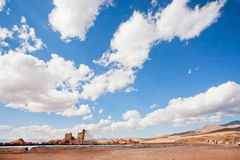White clouds over the destroyed walls of Zoroastrian fire temple. Stock Photos