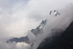 White clouds over Machhapuchchhre mountain - Fish Tail in Englis. H is a mountain in the Annapurna Himalya, Nepal Royalty Free Stock Photography