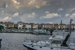 White clouds over the port. Of Cambrils in Spain Royalty Free Stock Photography