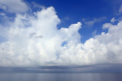 White clouds over sea. Summer day Royalty Free Stock Images