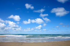 White clouds over the sea in P. Orthtowan, Cornwall UK Stock Photos