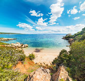 White clouds over a small cove in Alghero Royalty Free Stock Images