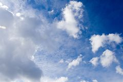 White clouds over vivid blue sky Royalty Free Stock Photo
