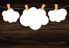 White clouds of paper hang on a rope with clothespins on the woo. Den background. Vector. Free space for text or advertising Stock Image