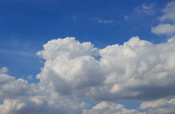 White clouds and rain clouds. In the blue sky Royalty Free Stock Image