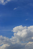 White clouds and rain clouds. In the blue sky Royalty Free Stock Images