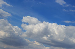 White clouds and rain clouds. In the blue sky Royalty Free Stock Photography