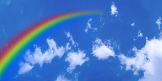 White Clouds and Rainbow in Blue Sky royalty free illustration