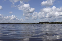 White clouds and ripples on the lake Royalty Free Stock Photography