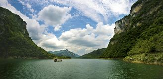 White Clouds & River ,Canyon Stock Image