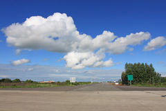 White clouds and road Royalty Free Stock Photos