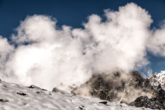 White clouds in the rugged mountains of the Caucasus. 3000 meters above sea level Royalty Free Stock Photos