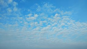 4k time lapse white clouds running over blue sky stock video