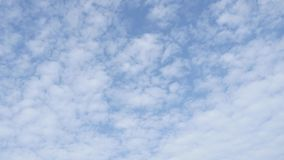 White clouds running over blue sky stock video footage