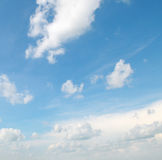 White clouds on a  sky background Stock Photos
