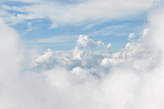 White clouds in the sky. White puffy clouds in the sky. View from top of mountain Royalty Free Stock Photography