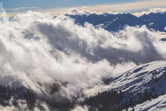 White Clouds on Snow Mountains at Daylight Photography Royalty Free Stock Photo