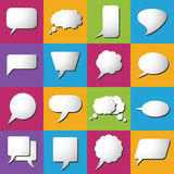 White clouds speak bubbles on color background Stock Photos