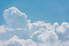 White clouds. Summer sky with with white fluffy clouds on the blue sky Royalty Free Stock Image