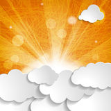 White clouds with sun rays on an orange background Royalty Free Stock Images
