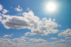 White clouds and sun in sky Royalty Free Stock Photo