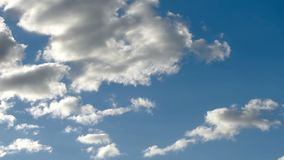 White clouds sweeping the sky stock footage