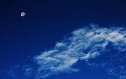 White Clouds Under Blue Sky With Gibbous Moon Royalty Free Stock Images