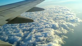 White clouds under the wing of the aircraft during the flight.  stock video footage