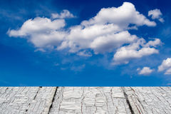 White Cloudscape and Aged Timber Royalty Free Stock Images