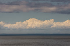 White cloudscape over Atlantic ocean, Scotland. Stock Photos