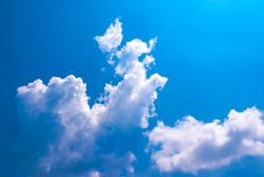 White cloudy and blue sky background, look like a dog running on the clouds, so cute. White cloudy and blue sky background in the, that looks like a dog running royalty free stock images