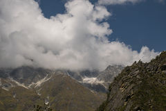 White Cloudy mountains new view Stock Images