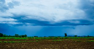 White cloudy sky and blue sky background over the local rice fields in countryside landscape of Thailand. Stone Mountain View and beautiful blue sky with white stock photo