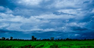 White cloudy sky and blue sky background over the local rice fields in countryside landscape of Thailand. Stone Mountain View and beautiful blue sky with white royalty free stock photos