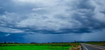White cloudy sky and blue sky background over the local rice fields in countryside landscape of Thailand. Stone Mountain View and beautiful blue sky with white royalty free stock image