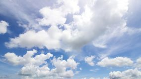 White cloudy sky daytime in summer. On blue background Royalty Free Stock Photos