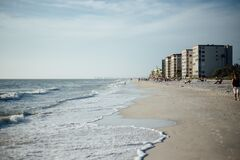 White Cloudy Sky over Seashore With Buildings during Daytime Royalty Free Stock Photos