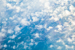 White cloudy sky. View from airplane flying in clouds. Royalty Free Stock Image