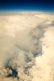 White cloudy sky. View from airplane flying in clouds. Royalty Free Stock Photography