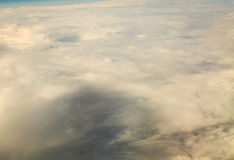 White cloudy sky. View from airplane flying in clouds. Stock Photos