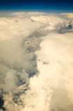 White cloudy sky. View from airplane flying in clouds. Royalty Free Stock Images